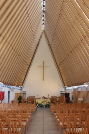 The 'Cardboard Cathedral' design includes cardboard tubes and shipping containers.